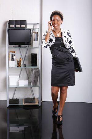 Cute executive walks in Stock Photo - 6594009