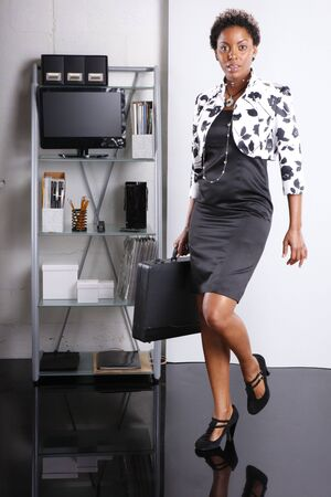 Cute executive walks in Stock Photo - 6593943