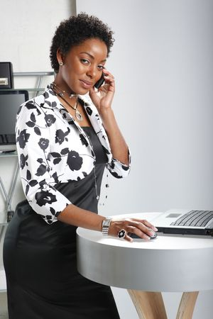 making dresses: Cute executive on a business call Stock Photo