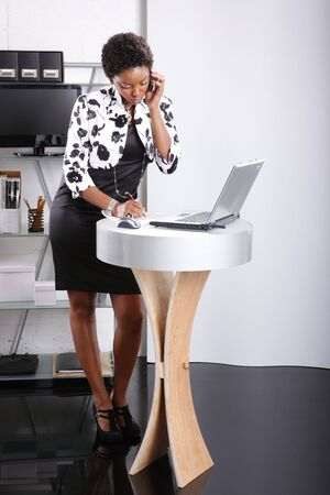 Cute executive on a business call Stock Photo - 6593912