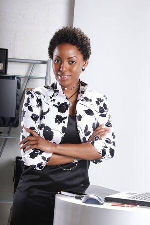 Cute executive standing confident Stock Photo - 6594044