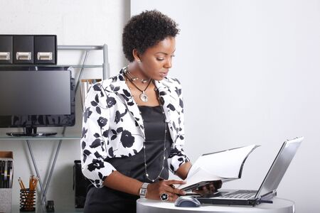 Cute executive interacts with her computer Stock Photo - 6593933