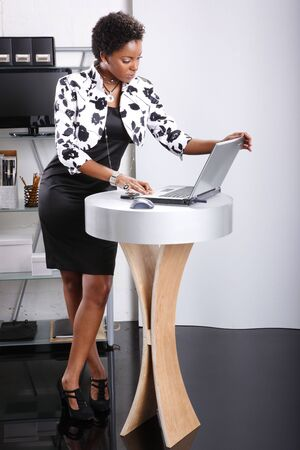 making dresses: Cute executive interacts with her computer