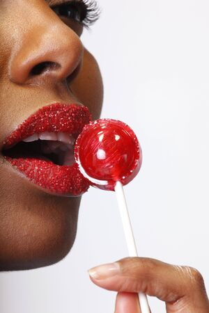indulging: Cute african american and her sweet cravings