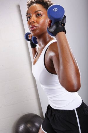 Cute afro-american and her workout routine photo