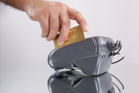 eftpos: Swiping a credit or debit card through a transaction terminal