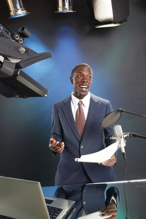 TVRadio news anchor with prompter and microphone photo