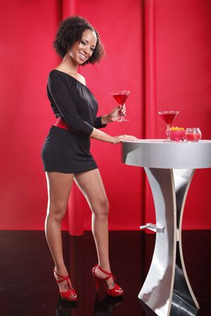 lounge: Little black dress on red lounge and Cosmopolitan cocktail