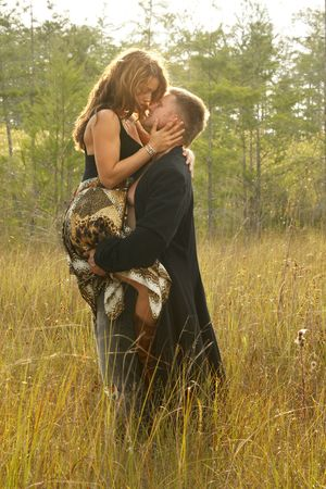 love park: Couple in love on wild grass Stock Photo