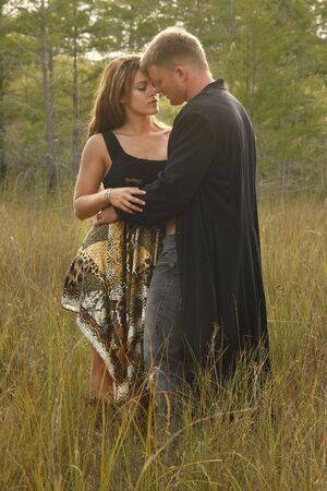 Couple in love on wild grass Stock Photo - 7034960