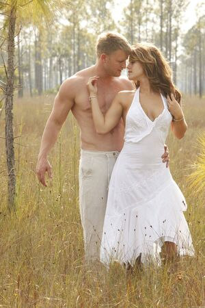 Couple in love on wild grass photo