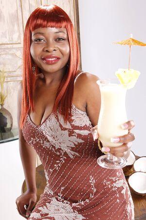 Cute african-american enjoying a pina colada cocktail photo