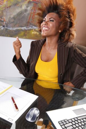 Corporate executive claims victory at her desk Stock Photo - 7216735