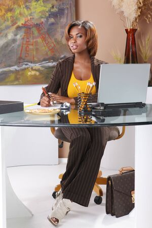 Cute executive at her desk Stock Photo - 7216740