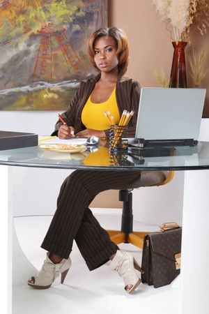Cute executive at her desk Stock Photo - 7216712