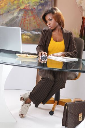 Cute executive at her desk Stock Photo - 7216769
