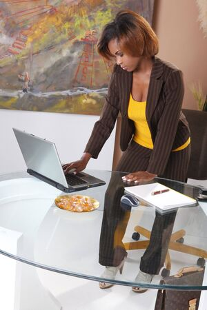 Cute executive standing at her desk Stock Photo - 7216741