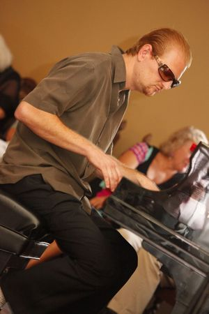 MIAMI BEACH - JUNE 20: Jazz Pianist Dave Siegel performs onstage at Jamie Ousley Latest CD release at Bath Club, June 20, 2010