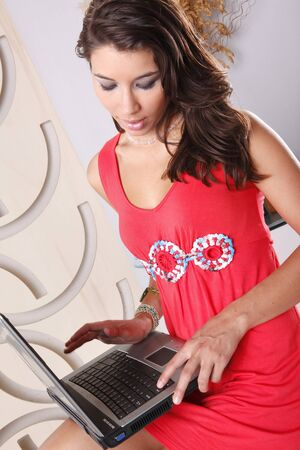 Cute brunette working with laptop photo