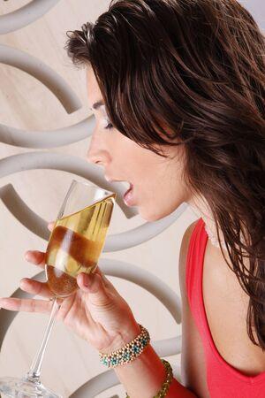Cute brunette having white wine photo