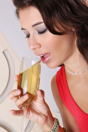 Cute brunette having white wine Stock Photo - 7263486