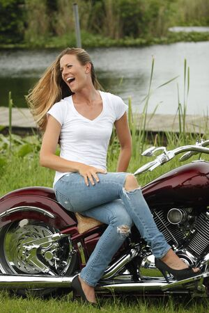 Fit woman on her low rider chopper photo
