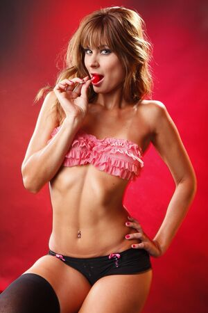 Lollypop diva on red background photo