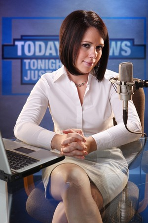 news reporter: Cute brunette at radio station