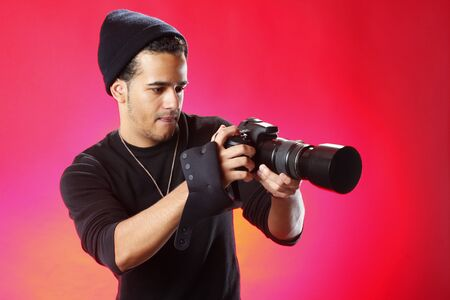 photo studio: Young photographer on red background