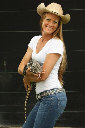 handler: Animal handler with Asian water monitor lizard