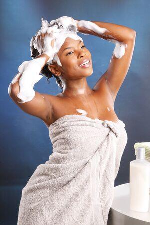 Cute African American using shampoo photo