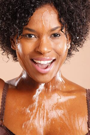 woman profile: Cute African American with water dripping through her face Stock Photo