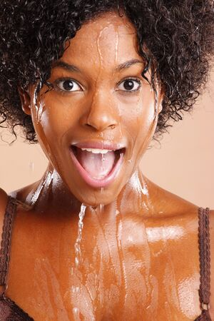african woman face: Cute African American with water dripping through her face Stock Photo