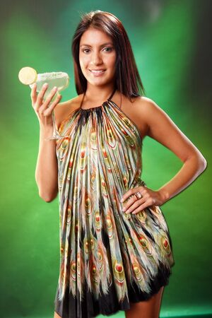 margarita cocktail: Cute brunette and Margarita cocktail on green