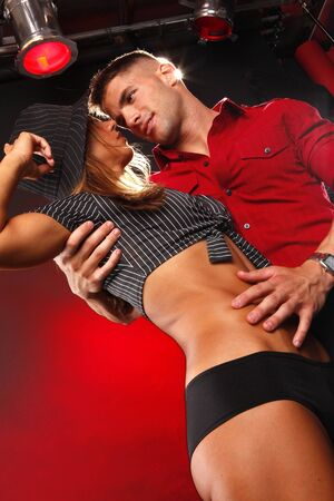 Hot young couples passion at the nightclub photo