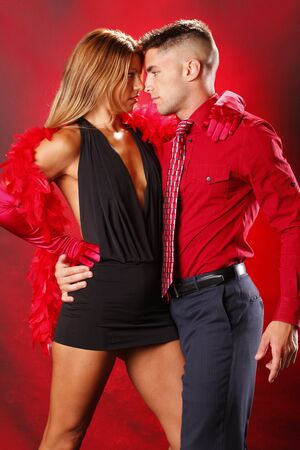 Passion couple on red background photo