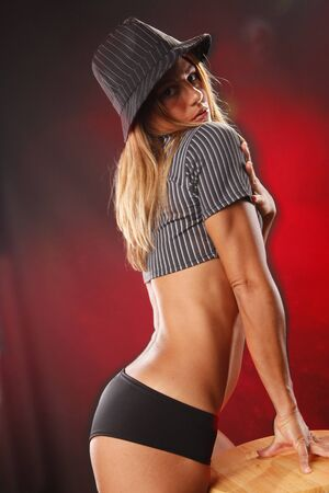 stool: Stripe hat on red Stock Photo
