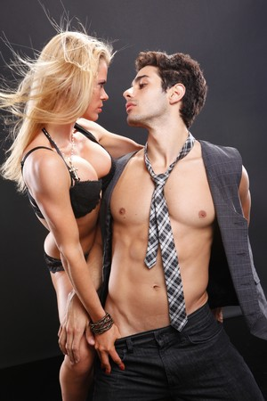 adult sex: Passionate couple show their affection Stock Photo