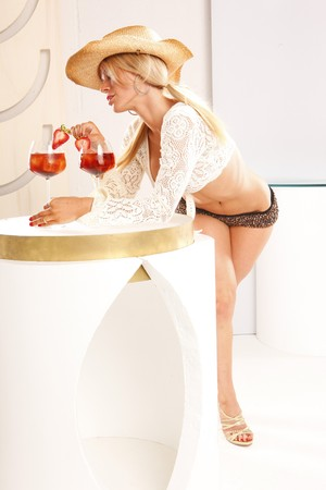 Joyful attitudes of blond that enjoys a refreshing cocktail Stock Photo - 7484193