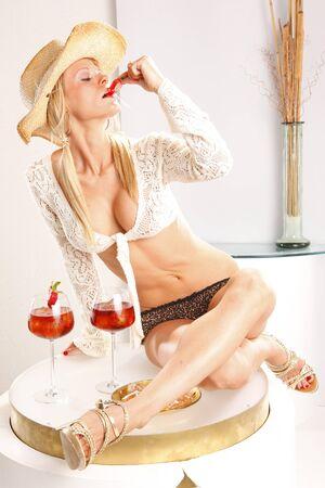 Joyful attitudes of blond that enjoys a refreshing cocktail photo