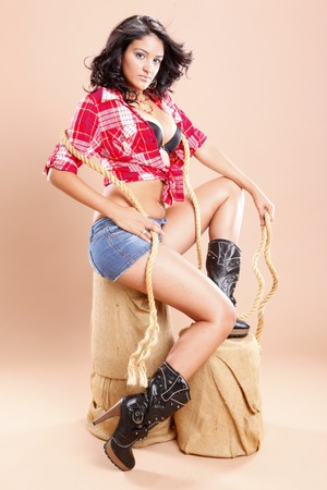 Cowgirl and rope on sisal stool photo