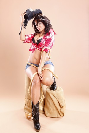 sexy boots: Cowgirl and rope on sisal stool