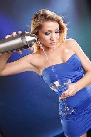 liquor girl: Cute blond and blue kamikaze cocktail Stock Photo