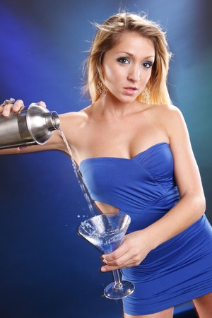 martini shaker: Cute blond and blue kamikaze cocktail Stock Photo