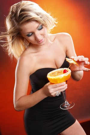 cocktail dress: Cute blond and mango margarita cocktail Stock Photo