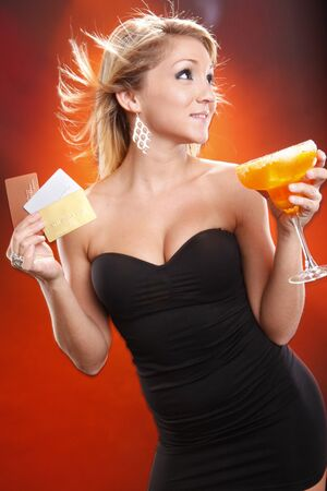 Cute blond pays for her mango margarita cocktail with plastic