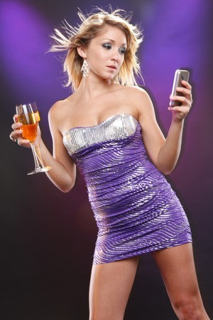 celphone: Cute model texting while having wine