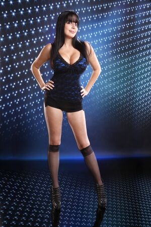 Cute brunette on a blue disco setting photo