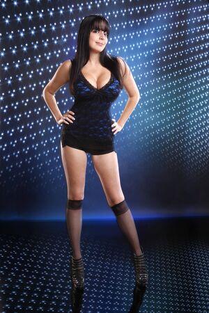Cute brunette on a blue disco setting