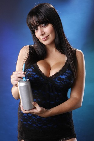 Cute brunette having a silver soda photo